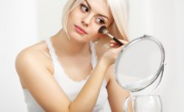 Beauty Girl with Makeup Brush. Daily Make-up for Blond Woman.